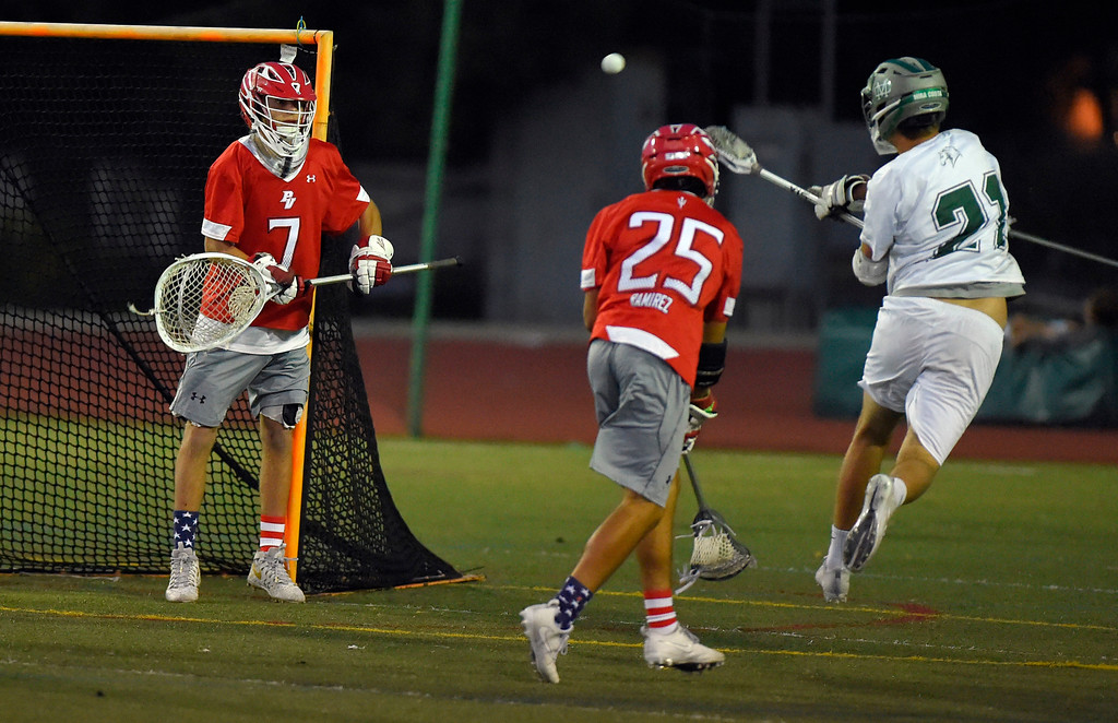 . Mira Costa�s Max Geoghegan takes a shot at the goal but is stopped by PV goalie JJ Barry in Manhattan Beach, CA on Thursday, April 20, 2017. Bay League boys lacrosse match - Palos Verdes vs Mira Costa. (Photo by Scott Varley, Daily Breeze/SCNG)