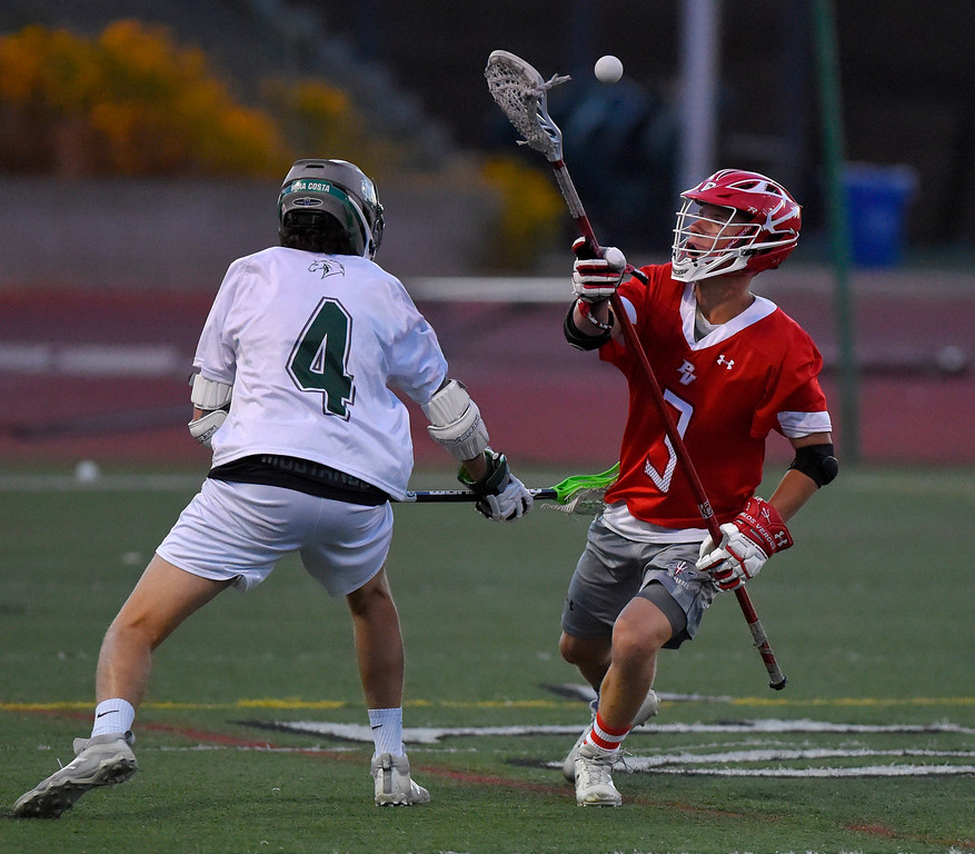 . PV�s Kyle McBride, right, juggles loose ball he took from Mira Costa�s Zach Horowitz in Manhattan Beach, CA on Thursday, April 20, 2017. Bay League boys lacrosse match - Palos Verdes vs Mira Costa. (Photo by Scott Varley, Daily Breeze/SCNG)