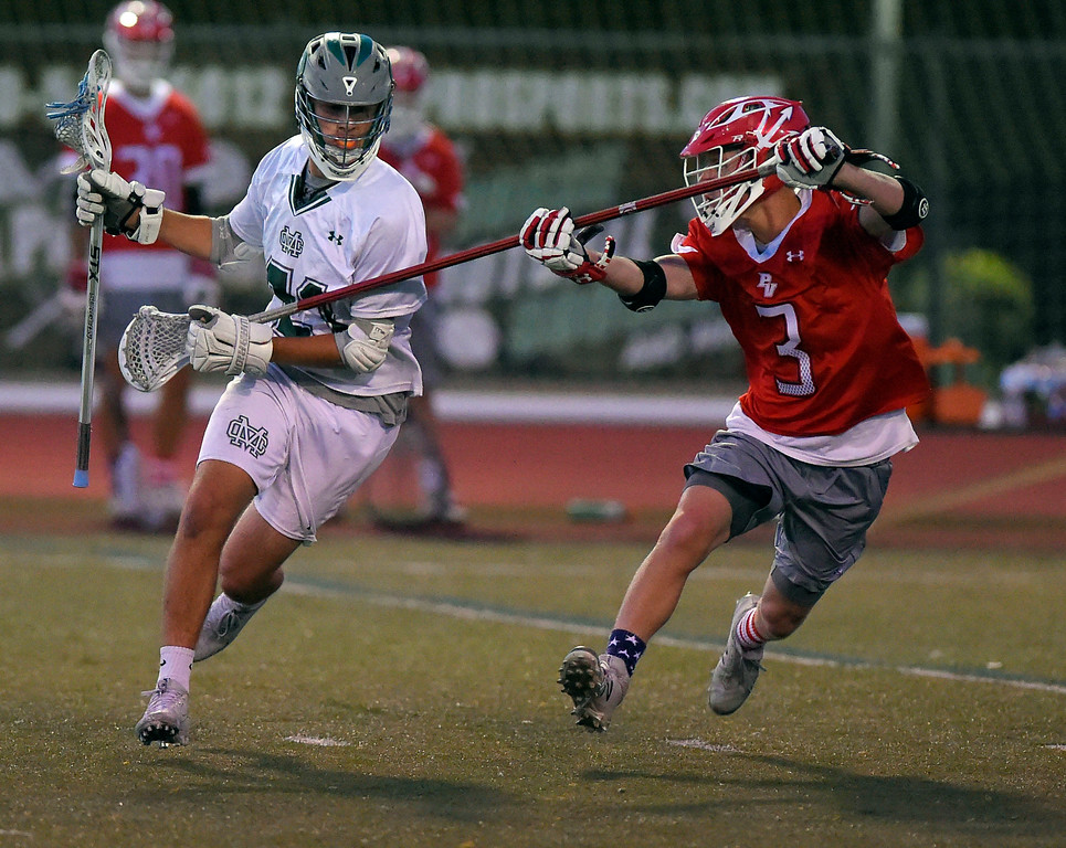 . Mira Costa�s Max Geoghegan, left, keeps the ball away from PV�s Kyle McBride in Manhattan Beach, CA on Thursday, April 20, 2017. Bay League boys lacrosse match - Palos Verdes vs Mira Costa. (Photo by Scott Varley, Daily Breeze/SCNG)