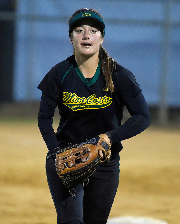 . Mira Costa right fielder Piper Neri in Redondo Beach, CA on Wednesday, April 26, 2017. Neri\'s right arm is mostly paralyzed after a nerve ruptured at birth, but she has been playing since she was 10 and has adapted. (Photo by Scott Varley, Daily Breeze/SCNG)