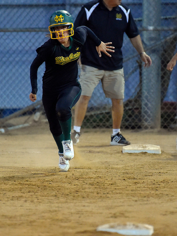 . Mira Costa right fielder Piper Neri sprints safely to second from first on a batted ball in Redondo Beach, CA on Wednesday, April 26, 2017. Neri\'s right arm is mostly paralyzed after a nerve ruptured at birth, but she has been playing since she was 10 and has adapted. (Photo by Scott Varley, Daily Breeze/SCNG)