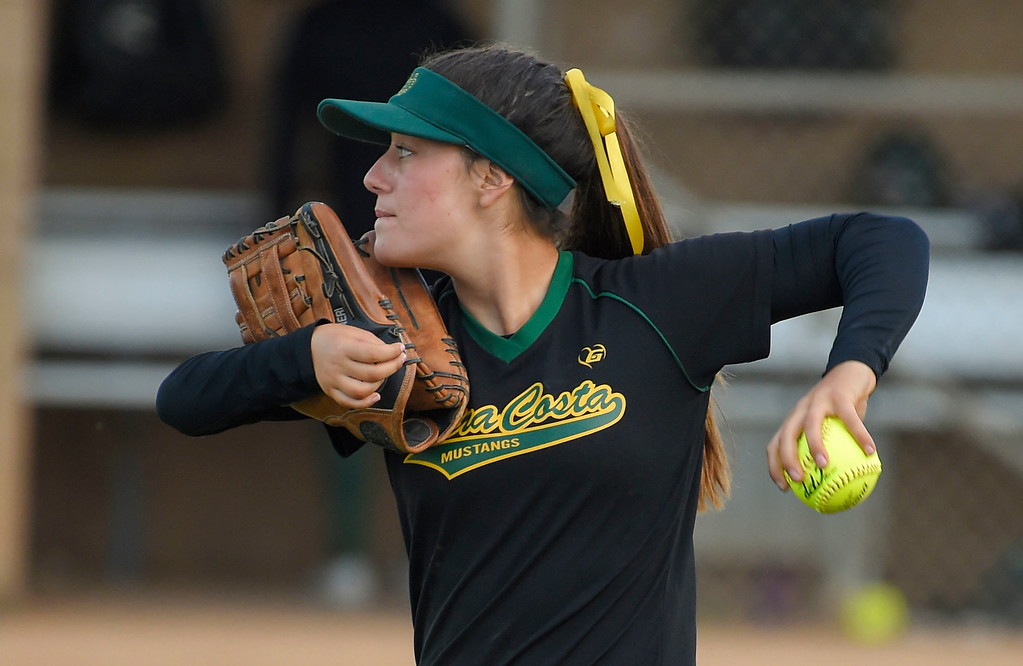 . Mira Costa right fielder Piper Neri warms up between innings in Redondo Beach, CA on Wednesday, April 26, 2017. Neri\'s right arm is mostly paralyzed after a nerve ruptured at birth, but she has been playing since she was 10 and has adapted. (Photo by Scott Varley, Daily Breeze/SCNG)
