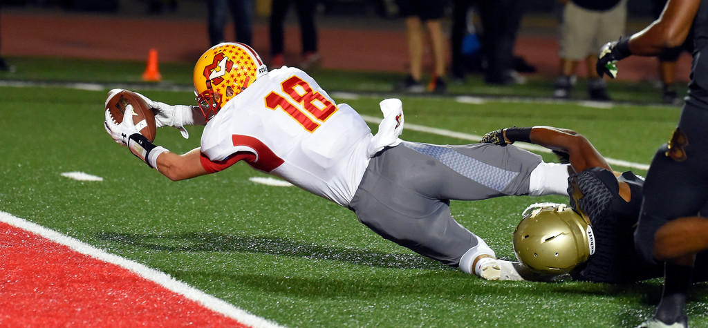 . Mission�s Austin Osborne gets tackled short of a TD in Long Beach on Friday, September 15, 2017. Mission Viejo vs Long Beach Poly preseason football at Veterans Stadium. (Photo by Scott Varley, Press-Telegram)