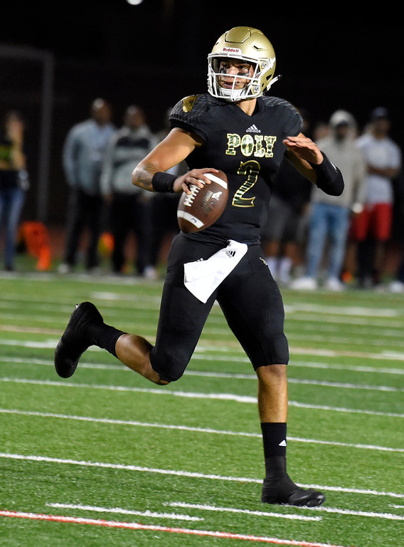 . Poly QB Matt Corral looks for a receiver in the end zone before making a pass across his body for an interception in Long Beach on Friday, September 15, 2017. Mission Viejo beat Long Beach Poly 12-7 in preseason football at Veterans Stadium. (Photo by Scott Varley, Press-Telegram)