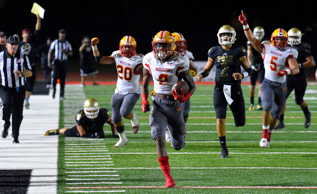 . Olaijah Griffin returns a 4th quarter interception for a TD and put the Diablos in the lead for good in Long Beach on Friday, September 15, 2017. Mission Viejo beat Long Beach Poly 12-7 in preseason football at Veterans Stadium. (Photo by Scott Varley, Press-Telegram)