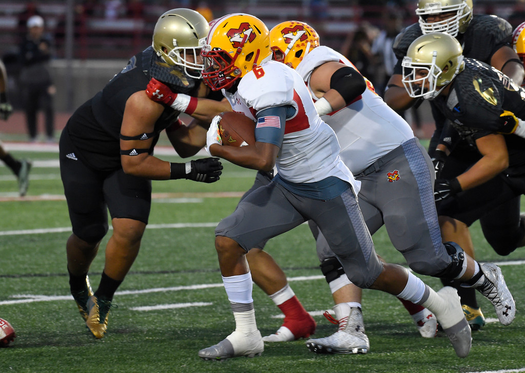 . Mission�s Akili Arnold picks up some yards in Long Beach on Friday, September 15, 2017. Mission Viejo vs Long Beach Poly preseason football at Veterans Stadium. (Photo by Scott Varley, Press-Telegram)