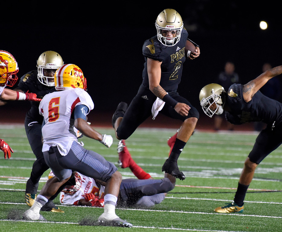 . Poly QB Matt Corral picks up some yards in Long Beach on Friday, September 15, 2017. Mission Viejo beat Long Beach Poly 12-7 in preseason football at Veterans Stadium. (Photo by Scott Varley, Press-Telegram)