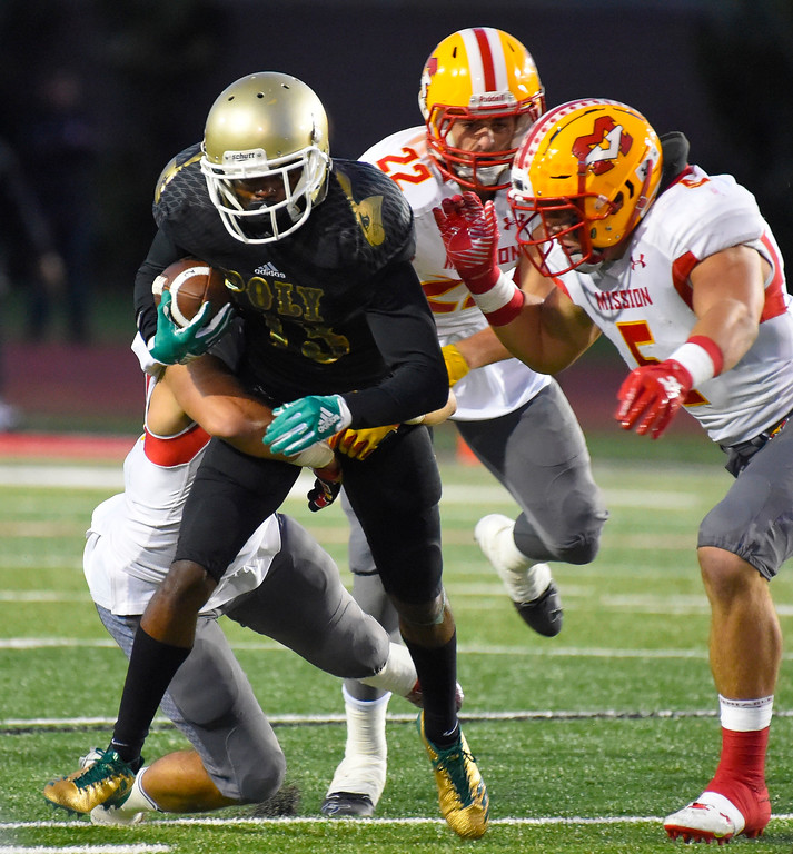 . Poly�s Malachi Tolliver gets stopped by a group of Mission defenders in Long Beach on Friday, September 15, 2017. Mission Viejo vs Long Beach Poly preseason football at Veterans Stadium. (Photo by Scott Varley, Press-Telegram)