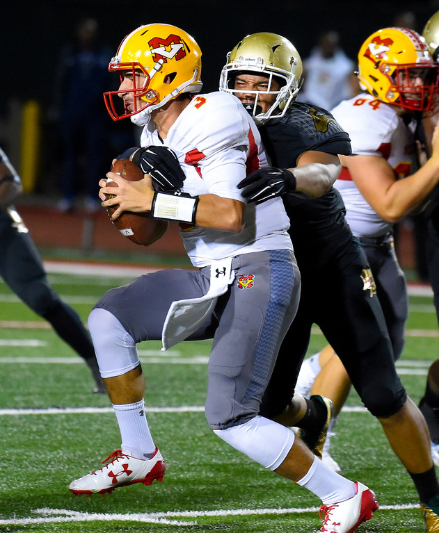 . Mission QB Joey Yellen is sacked by Poly�s Timothy Gomez in Long Beach on Friday, September 15, 2017. Mission Viejo vs Long Beach Poly preseason football at Veterans Stadium. (Photo by Scott Varley, Press-Telegram)
