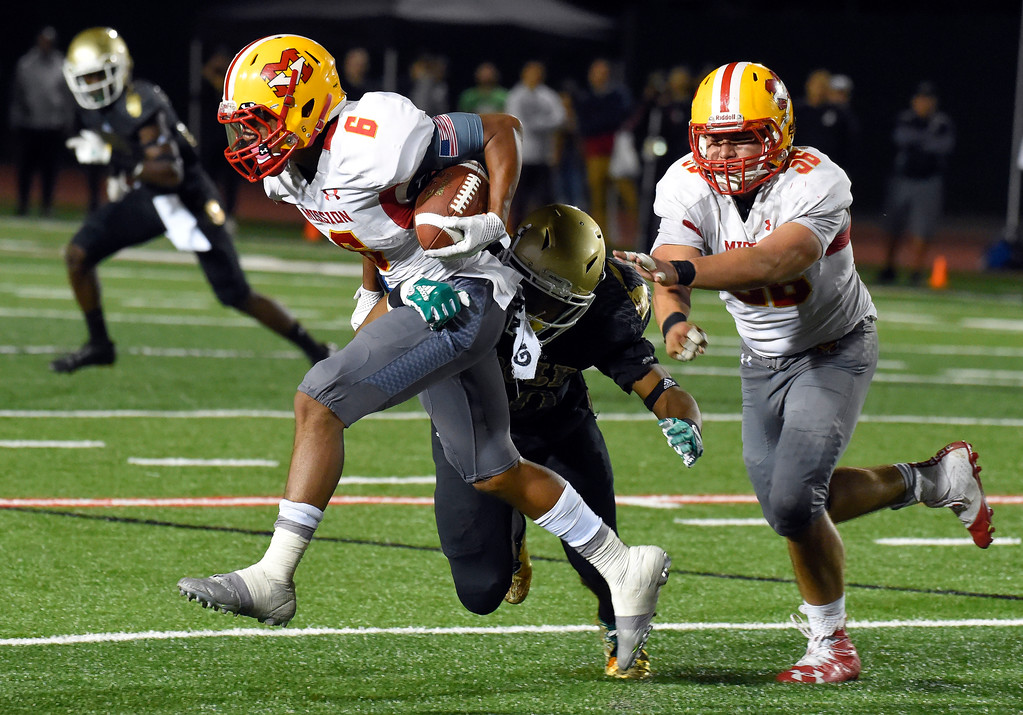 . Mission�s Akili Arnold gets stopped behind the line for a loss in Long Beach on Friday, September 15, 2017. Mission Viejo vs Long Beach Poly preseason football at Veterans Stadium. (Photo by Scott Varley, Press-Telegram)