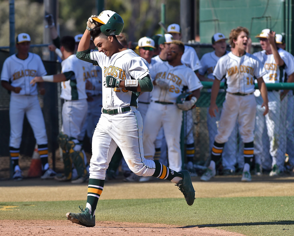 . Mira Costa beat visiting San Dimas 7-3 in CIF Southern Section Div 2 baseball playoff game played Friday May 19, 2017. Joey Acosta tips cap as he heads home after three-run homer. Photo By  Robert Casillas, Daily Breeze/ SCNG