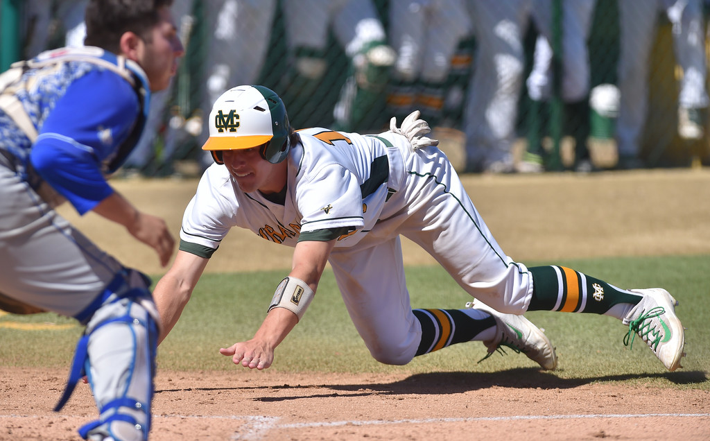 . Mira Costa beat visiting San Dimas 7-3 in CIF Southern Section Div 2 baseball playoff game played Friday May 19, 2017. Kohl Titzler dives home to score. Photo By  Robert Casillas, Daily Breeze/ SCNG