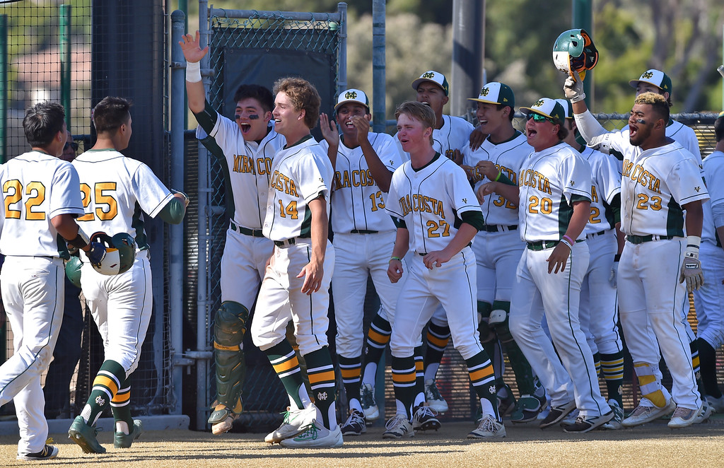 . Mira Costa beat visiting San Dimas 7-3 in CIF Southern Section Div 2 baseball playoff game played Friday May 19, 2017. Mira Costa players greet Joey Acosta after his three run homer broke game open. Photo By  Robert Casillas, Daily Breeze/ SCNG