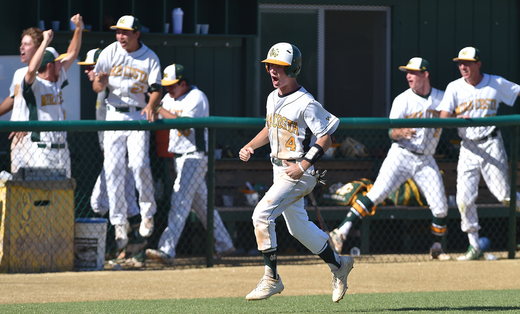 . Mira Costa beat visiting San Dimas 7-3 in CIF Southern Section Div 2 baseball playoff game played Friday May 19, 2017. Chase Meidroth celebrates as he scores on Acosta homer. Photo By  Robert Casillas, Daily Breeze/ SCNG