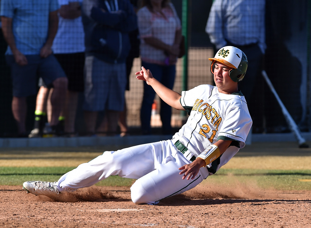 . Mira Costa beat visiting San Dimas 7-3 in CIF Southern Section Div 2 baseball playoff game played Friday May 19, 2017. Nick Solan scores on hit by Chase Meidroth. Photo By  Robert Casillas, Daily Breeze/ SCNG