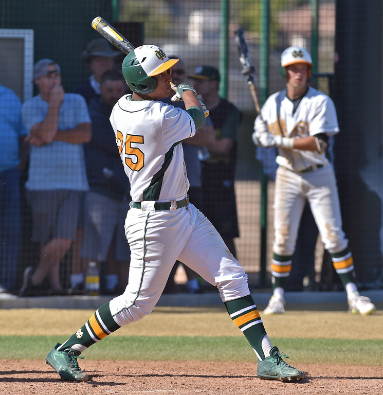 . Mira Costa beat visiting San Dimas 7-3 in CIF Southern Section Div 2 baseball playoff game played Friday May 19, 2017. Joey Acosta watches flight of his three-run bomb in fourth. Photo By  Robert Casillas, Daily Breeze/ SCNG
