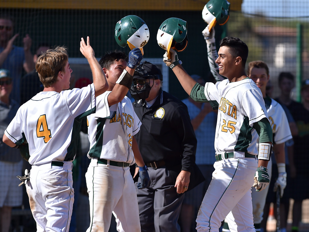 . Mira Costa beat visiting San Dimas 7-3 in CIF Southern Section Div 2 baseball playoff game played Friday May 19, 2017. Joey Acosta, right, celebrates at plate after three run homer broke game open for Mira Costa. Photo By  Robert Casillas, Daily Breeze/ SCNG