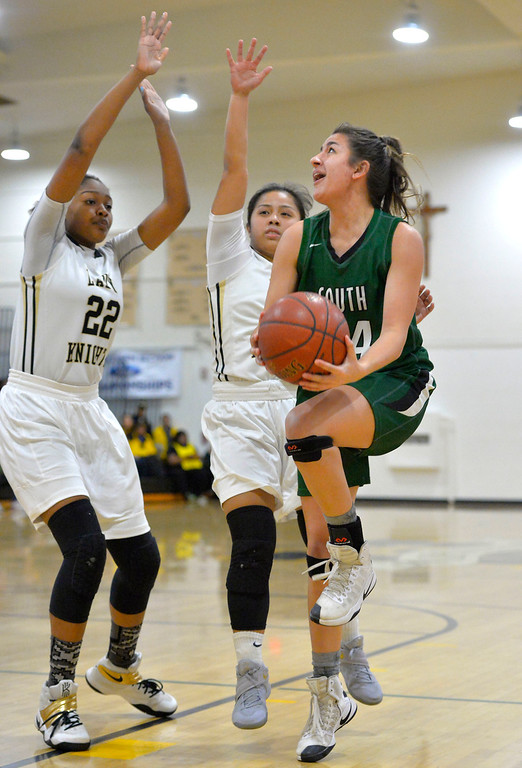 . South\'s Jenna Krynen gets pressured on a layup by Bishop\'s Raniyah Reynolds, left, and Jessica Malazarte in Torrance, CA on Thursday, February 16, 2017. Bishop Montgomery Lady Knights defeated South Spartans 69-52 in the first round of CIF-SS Div 1A girls basketball playoffs. (Photo by Scott Varley, Daily Breeze)