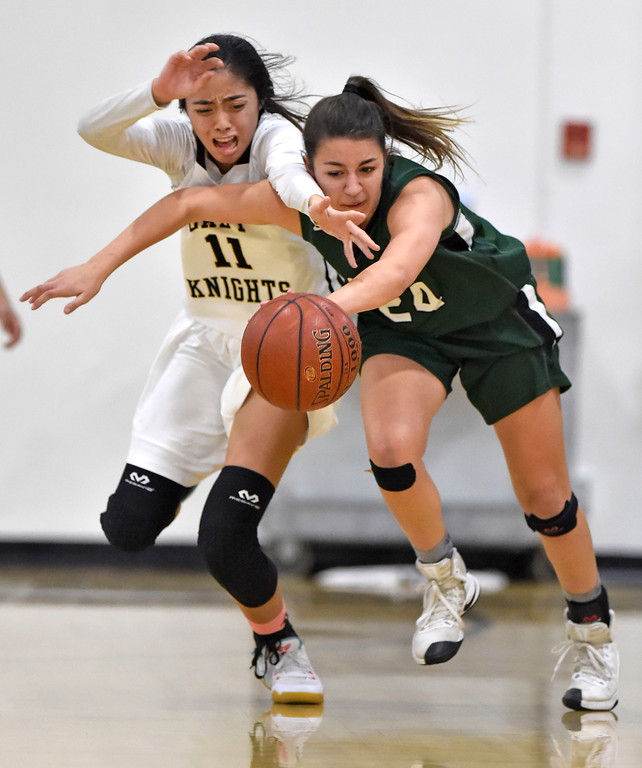. Bishop\'s Kayla Padilla, left, and South\'s Jenna Krynen collide as they go after a loose ball in Torrance, CA on Thursday, February 16, 2017. Bishop Montgomery Lady Knights defeated South Spartans 69-52 in the first round of CIF-SS Div 1A girls basketball playoffs. (Photo by Scott Varley, Daily Breeze)