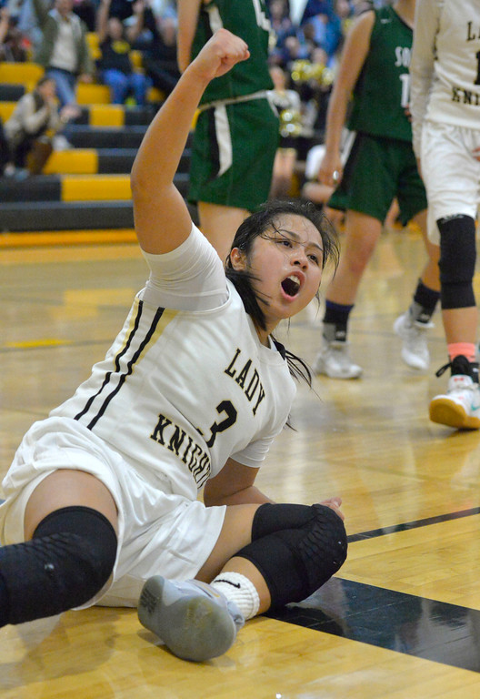 . Bishop\'s Jessica Malazarte celebrates a basket as she hits the deck in Torrance, CA on Thursday, February 16, 2017. Bishop Montgomery Lady Knights defeated South Spartans 69-52 in the first round of CIF-SS Div 1A girls basketball playoffs. (Photo by Scott Varley, Daily Breeze)