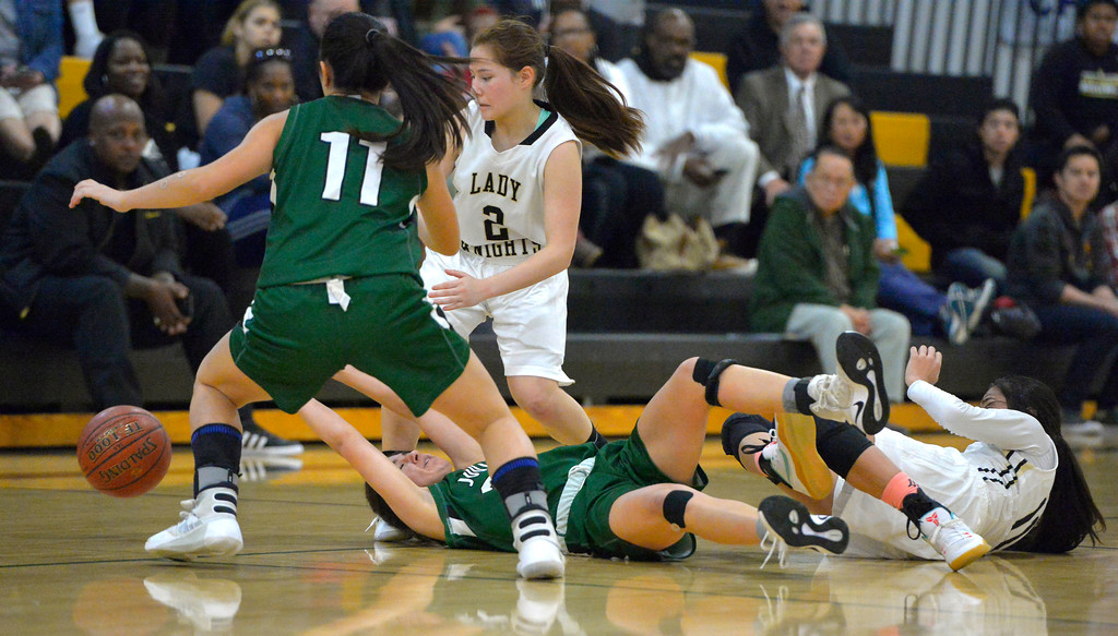 . Players hit the court chasing after a loose ball in Torrance, CA on Thursday, February 16, 2017. Bishop Montgomery Lady Knights defeated South Spartans 69-52 in the first round of CIF-SS Div 1A girls basketball playoffs. (Photo by Scott Varley, Daily Breeze)