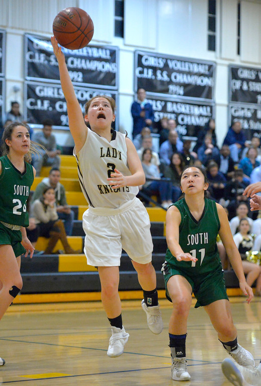 . Bishop freshman Nicole Hayase lays up the ball for a basket in Torrance, CA on Thursday, February 16, 2017. Bishop Montgomery Lady Knights defeated South Spartans 69-52 in the first round of CIF-SS Div 1A girls basketball playoffs. (Photo by Scott Varley, Daily Breeze)