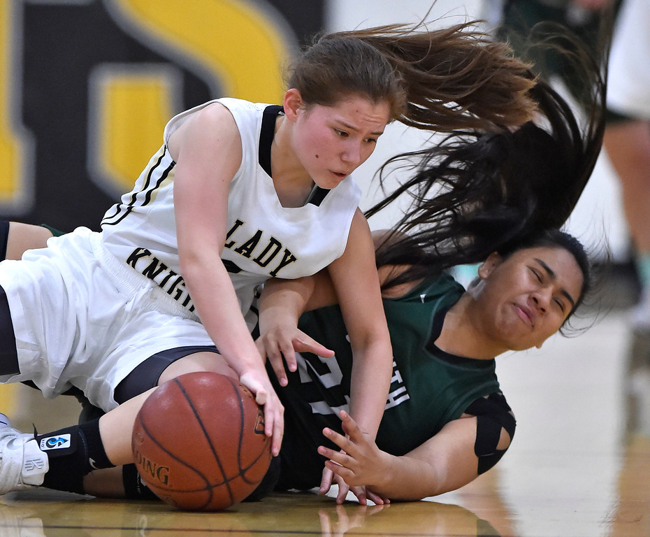 . Bishop\'s Nicole Hayase, left, and South\'s Kelly Hussey crash to the floor diving after a loose ball in Torrance, CA on Thursday, February 16, 2017. Bishop Montgomery Lady Knights defeated South Spartans 69-52 in the first round of CIF-SS Div 1A girls basketball playoffs. (Photo by Scott Varley, Daily Breeze)