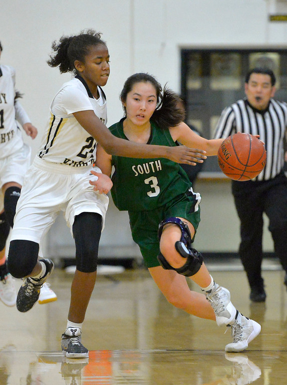 . South\'s Allie Miya tries to keep the ball away from Bishop\'s Sophia Carroll in Torrance, CA on Thursday, February 16, 2017. Bishop Montgomery Lady Knights defeated South Spartans 69-52 in the first round of CIF-SS Div 1A girls basketball playoffs. (Photo by Scott Varley, Daily Breeze)