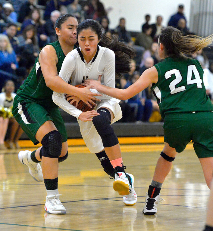 . Despite pressure from South\'s Kelly Hussey, left, and Jenna Krynen, right, Bishop\'s Kayla Padilla is able to get through for a basket in Torrance, CA on Thursday, February 16, 2017. Bishop Montgomery Lady Knights defeated South Spartans 69-52 in the first round of CIF-SS Div 1A girls basketball playoffs. (Photo by Scott Varley, Daily Breeze)
