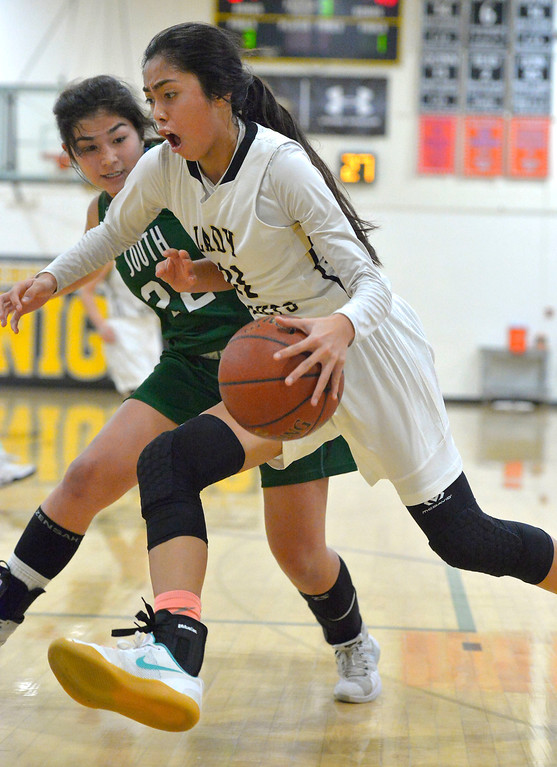 . Bishop\'s Kayla Padilla is fouled by South\'s Rachel Hayashi as she drives the baseline in Torrance, CA on Thursday, February 16, 2017. Bishop Montgomery Lady Knights defeated South Spartans 69-52 in the first round of CIF-SS Div 1A girls basketball playoffs. (Photo by Scott Varley, Daily Breeze)
