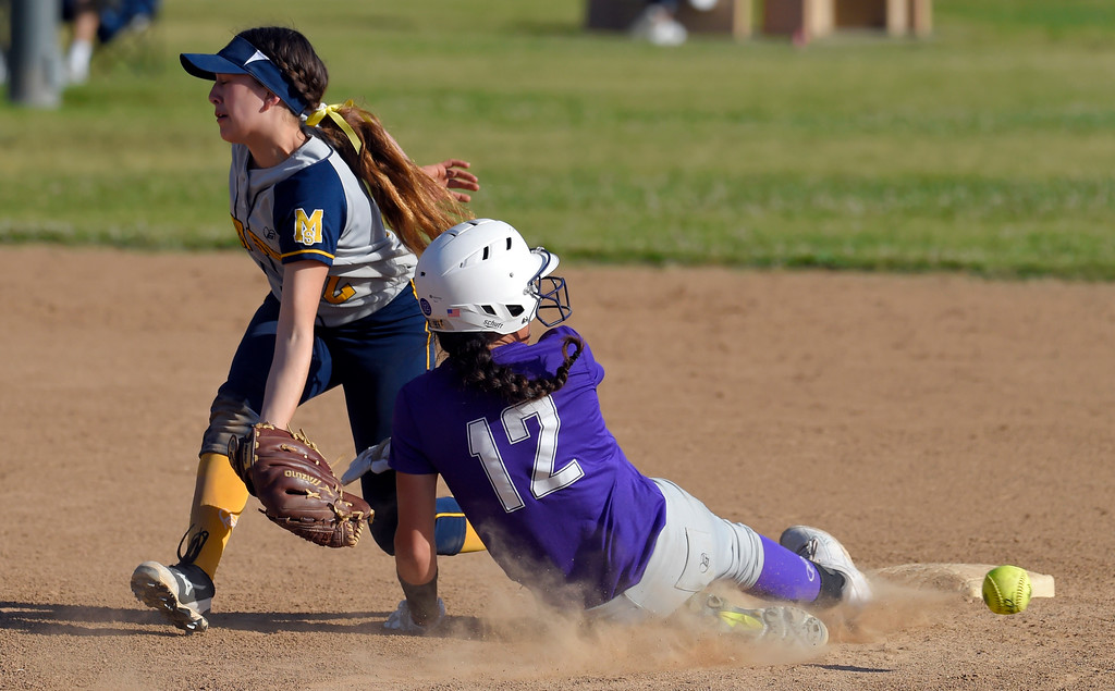 . St. Anthony�s Thessa Malau�ulu steals second base in the 7th inning as Mary Star�s Jillian Duran can�t make the catch in Long Beach on Wednesday, April 12, 2017. Malau�ulu advanced to third on the error and eventually scored the game-winning run. St. Anthony beat Mary Star 4-3. (Photo by Scott Varley, Press-Telegram/SCNG)