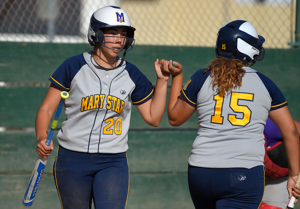 . After scoring to tie the game at 3-3 in the 7th inning, Mary Star�s Gianna Fletcher, left, is congratulated by Alessandra Samperio in Long Beach on Wednesday, April 12, 2017. St. Anthony beat Mary Star 4-3. (Photo by Scott Varley, Press-Telegram/SCNG)