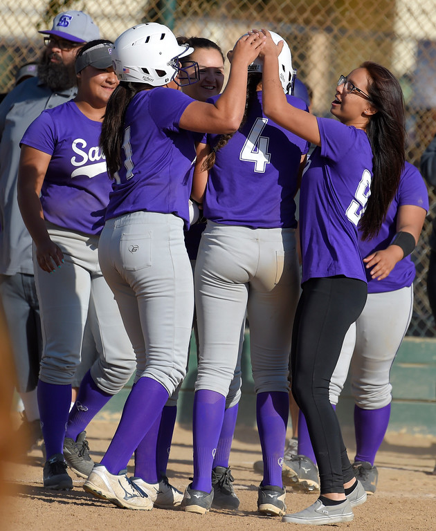 . St. Anthony teammates mob Tiare Jennings (4) after shit hit in the game-winning run in the bottom of the 7th inning in Long Beach on Wednesday, April 12, 2017. St. Anthony beat Mary Star 4-3. (Photo by Scott Varley, Press-Telegram/SCNG)
