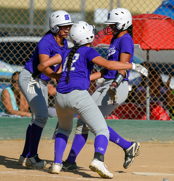 . St. Anthony�s Tiare Jennings, right, scores on an error in Long Beach on Wednesday, April 12, 2017. St. Anthony beat Mary Star 4-3. (Photo by Scott Varley, Press-Telegram/SCNG)