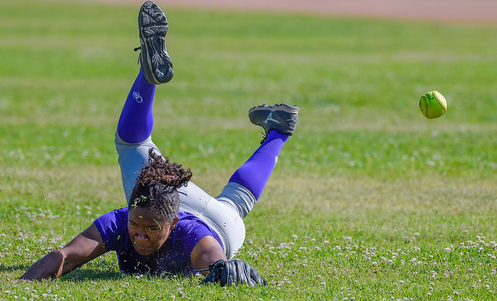 . St. Anthony center fielder Morgan Smith comes up short diving for a fly ball in Long Beach on Wednesday, April 12, 2017. St. Anthony beat Mary Star 4-3. (Photo by Scott Varley, Press-Telegram/SCNG)
