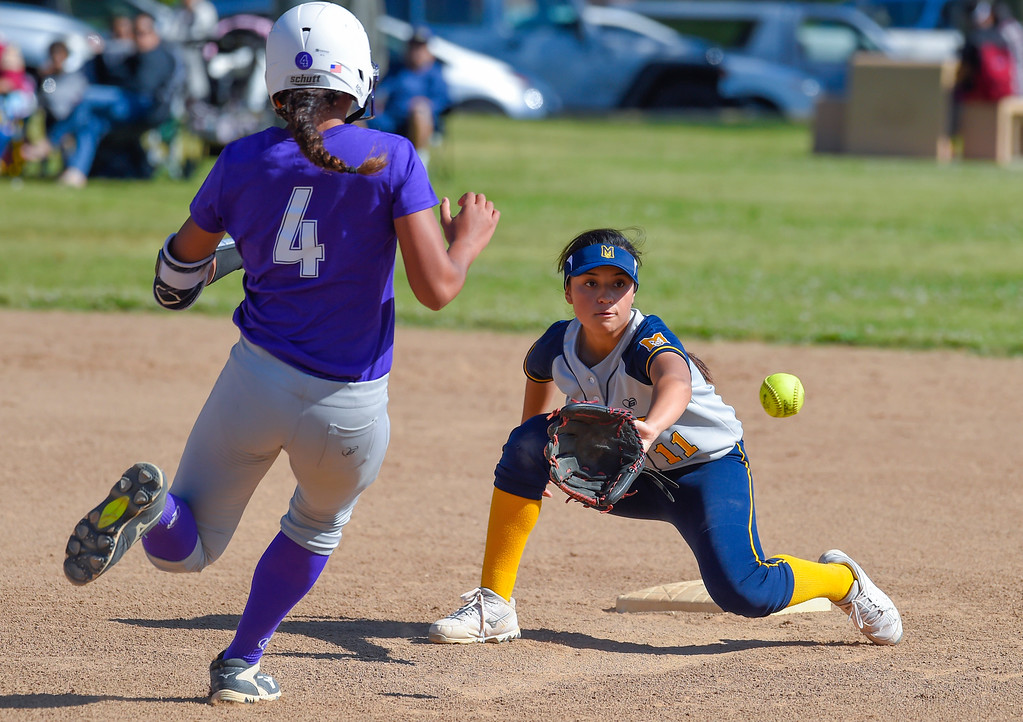 . Mary�s Star�s Ashley Rico catches the ball to put out St. Anathony�s Tiare Jennings at second base in Long Beach on Wednesday, April 12, 2017. St. Anthony beat Mary Star 4-3. (Photo by Scott Varley, Press-Telegram/SCNG)