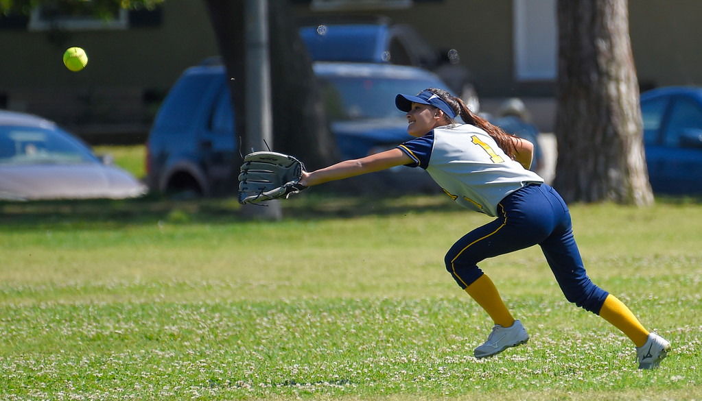 . Mary Star left fielder Sky Marquez can�t reach  ball hit for a homerun by St. Anthony�s Chloe Malau in Long Beach on Wednesday, April 12, 2017. St. Anthony beat Mary Star 4-3. (Photo by Scott Varley, Press-Telegram/SCNG)