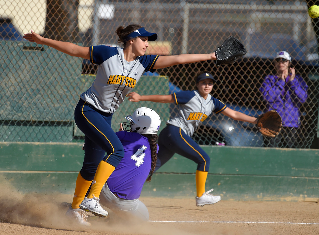 . St. Anthony�s Tiare Jennings slides safely into third base before scoring on this error in Long Beach on Wednesday, April 12, 2017. St. Anthony beat Mary Star 4-3. (Photo by Scott Varley, Press-Telegram/SCNG)