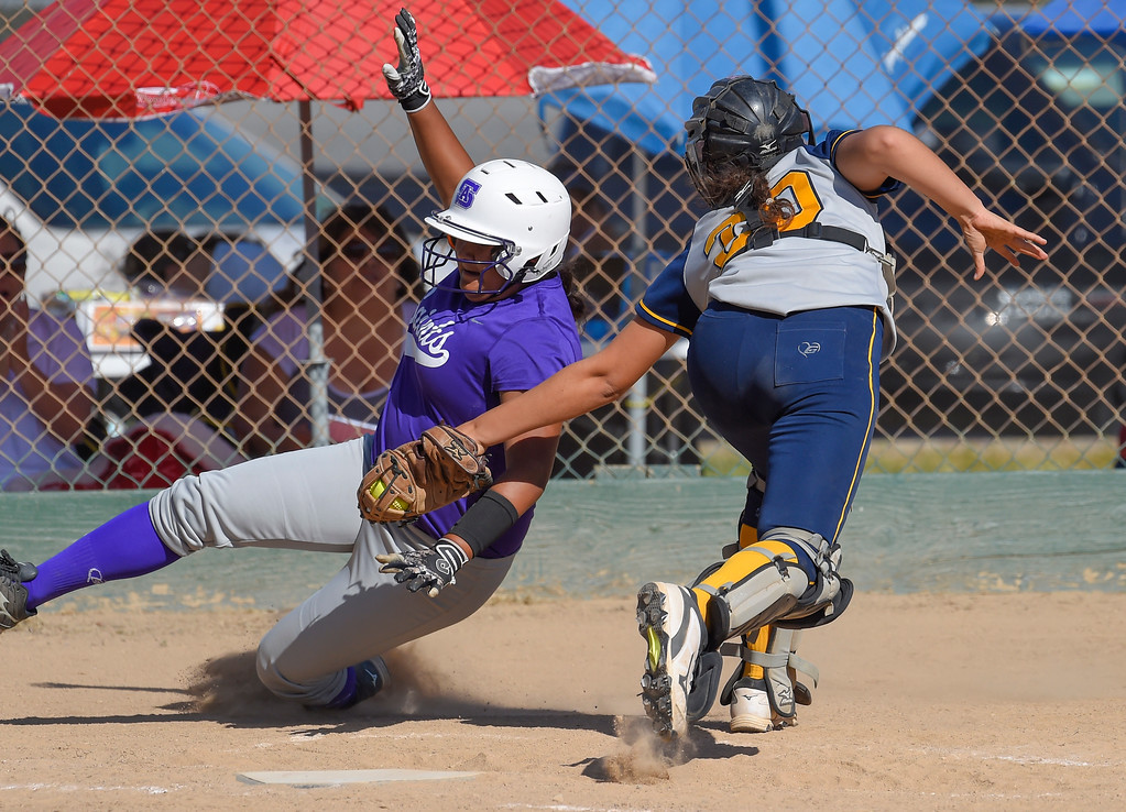 . Mary Star catcher Gianna Fletcher tags St. Anthony�s Jaelene Kapu out at home plate in Long Beach on Wednesday, April 12, 2017. St. Anthony beat Mary Star 4-3. (Photo by Scott Varley, Press-Telegram/SCNG)