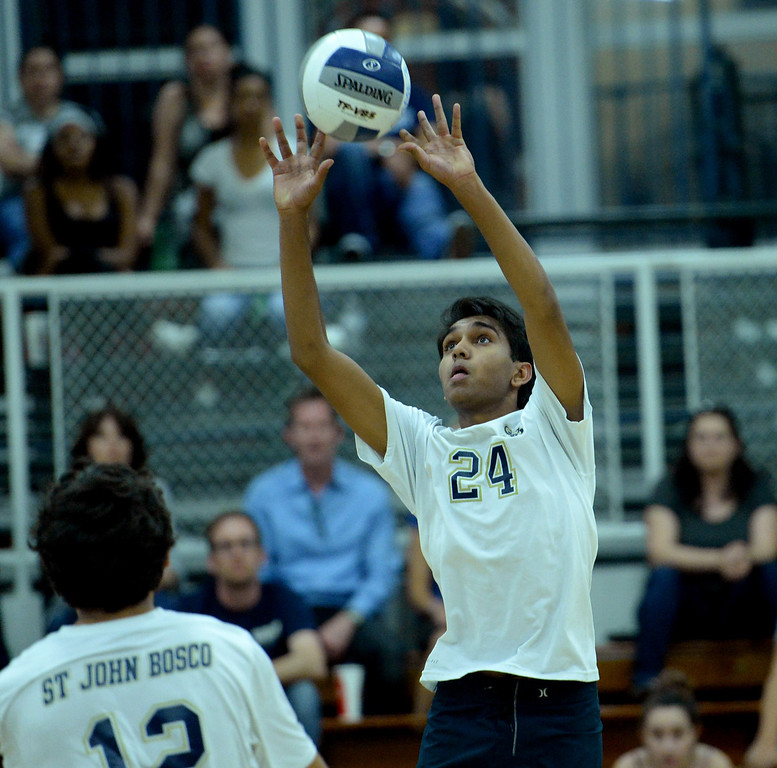 . St. John Bosco\'s Neville Morgan sets the ball against West Ranch in the CIF-SS Division 1 Boys\' Volleyball Playoff game in Bellflower, CA. on Tuesday May 13, 2014. (Photo by Sean Hiller/ Daily Breeze).