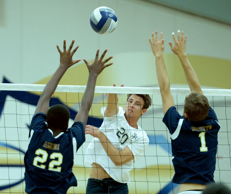 . St. John Bosco\'s Ryan Bahaddursingh over powers West Ranch\'s Ozzie Amadi (22), left, and Victor Schmitd (1) in the CIF-SS Division 1 Boys\' Volleyball Playoff game in Bellflower, CA. on Tuesday May 13, 2014. (Photo by Sean Hiller/ Daily Breeze).