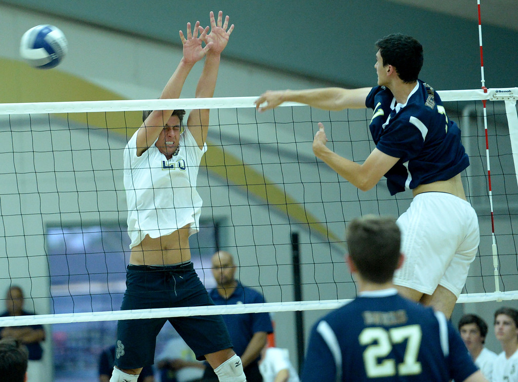 . St. John Bosco\'s Ryan Bahaddursingh is over powered by West Ranch\'s Andrew Dieterle in the CIF-SS Division 1 Boys\' Volleyball Playoff game in Bellflower, CA. on Tuesday May 13, 2014. (Photo by Sean Hiller/ Daily Breeze).