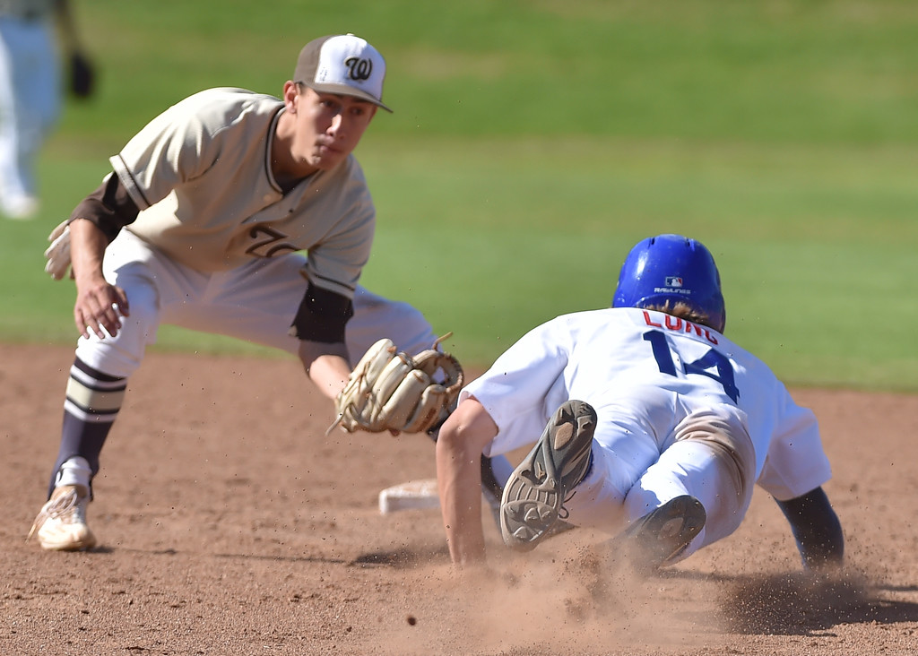 . El Segundo beat visiting West Torrance 6-3 in first round CIF Southern Section Division 3 baseball playoffs Thursday May 18, 2017. Spencer Long slides into waiting tag.   Photo By  Robert Casillas, Daily Breeze/ SCNG