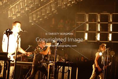 NIN Justin Meldal-Johnsen, Trent Reznor and Robin Finck May 20, 2009 Verizon Wireless Amphitheater Irvine, CA.  NINJA tour