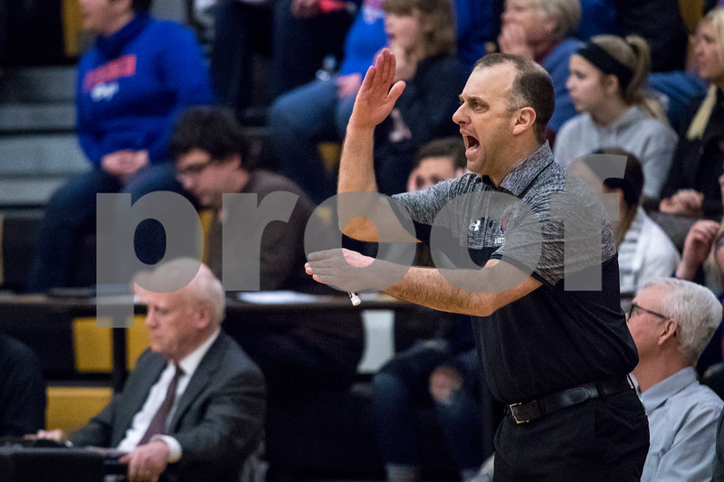 Sam Buckner for Shaw Media.<br /> Genoa-Kingston head coach Corey Jenkins calls a time out during the third quarter of their boys basketball regional semifinal game on Wednesday Mar. 1, 2017 at Sycamore High School in Sycamore.  Sycamore won 64-56.