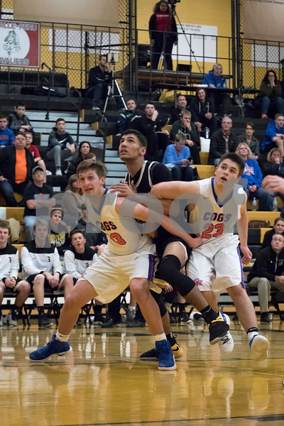 Sam Buckner for Shaw Media.<br /> Klint Wewetzer, left, and Justin Peters of  Genoa-Kingston box out Sycamore's Keyshawn Stallworth, center, during their boys basketball regional semifinal game on Wednesday Mar. 1, 2017 at Sycamore High School in Sycamore.  Sycamore won 64-56.
