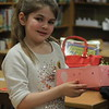 Kristi Garabrandt — The News-Herald <br> Addison Metrick shows off the boat she made with her family during the Family Literacy Night event at Longfellow Elementary School