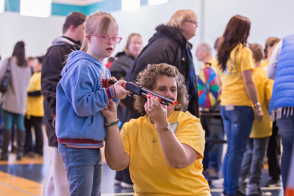 . Carrie Garland � The News-Herald <br> Volunteers interact with a guest March 3 at the Metzenbaum Center carnival in Chester Township.