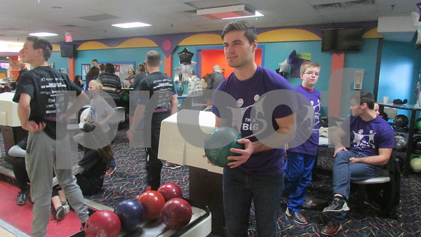 Kosta Pappas, 22, gets ready to bowl at the Big Brothers Big Sisters of DeKalb County Bowl for Kids' Sake event at Mardi Gras Lanes in DeKalb.