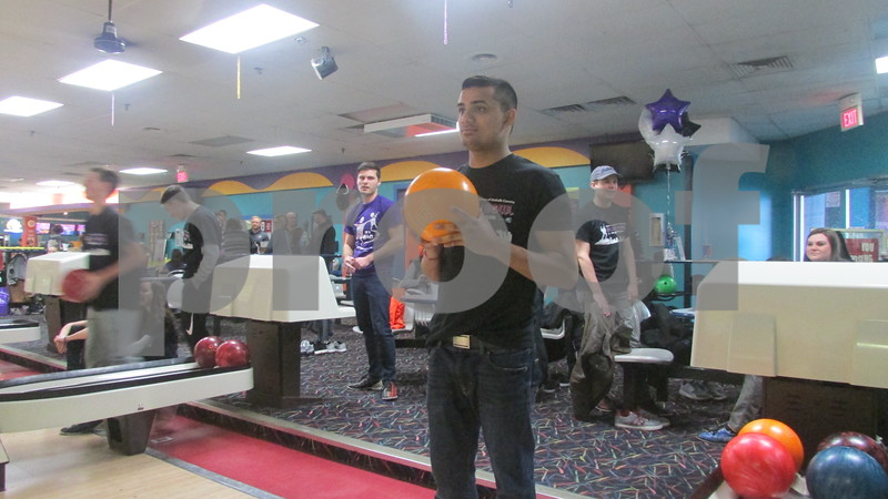 Ramneek Chitkara, manager at the Culver's in Sycamore, gets ready to bowl at the Big Brothers Big Sisters of DeKalb County Bowl for Kids' Sake event at Mardi Gras Lanes in DeKalb.